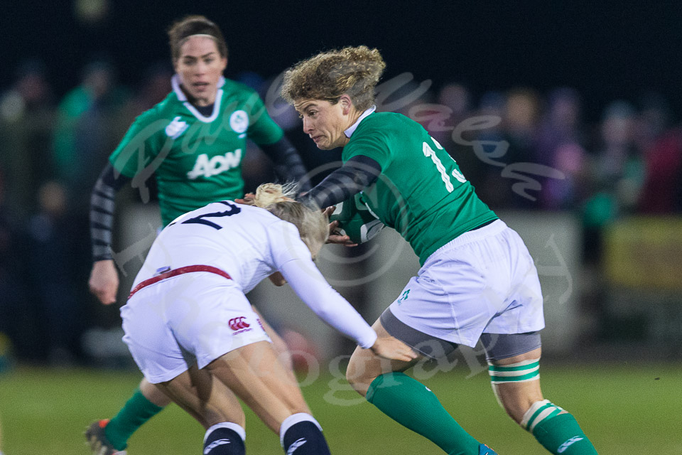 Jenny Murphy hands off tackle